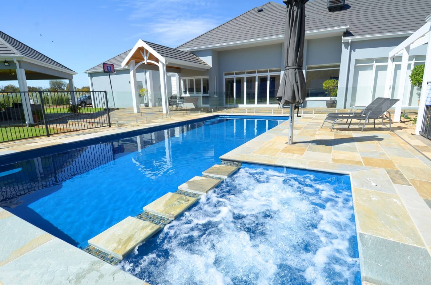 Swimming pool water features water walls bubblers and more - Swimming pool evaporation control ...
